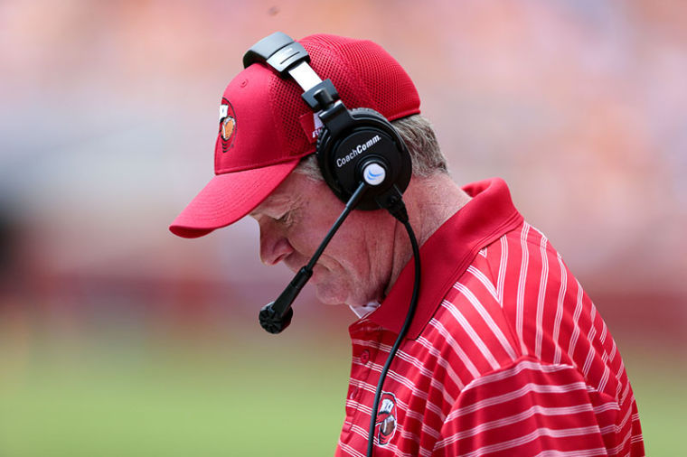 WKU head coach Bobby Petrino lowers his head after a play. WKU lost 52-20 against Tennessee in Knoxville, Tenn., on Saturday at Neyland Stadium.