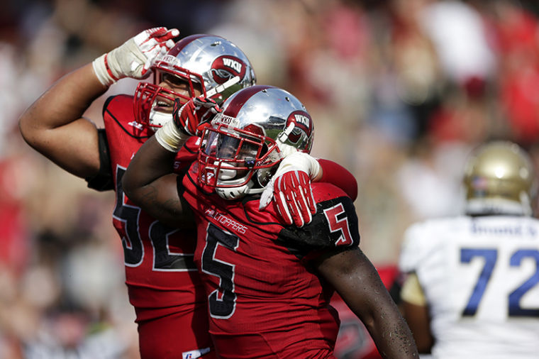 WKU's Antonio Andrews and Cameron Clemmons salute to the stands after Andrews scored a touchdown during their game against Navy at Western Kentucky University on Saturday, September 28, 2013.