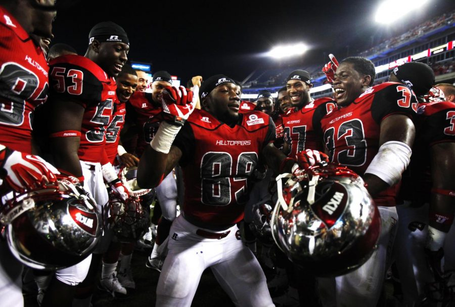 WKU sophomore wide receiver Stephon Brown, 89, dances in a circle of his teammates while celebrating Western's win against Kentucky at LP Field on Saturday, August 31.
