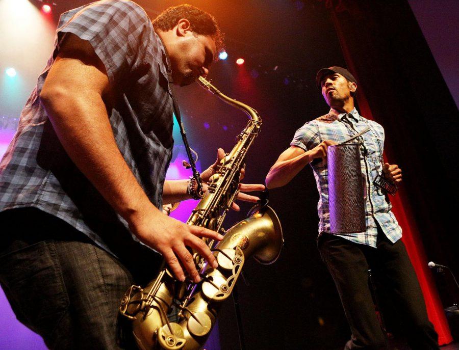 Ozomatli+band+members+Ulises+Bella+and+Justin+Poree+play+at+Van+Meter+Hall+on+Tuesday+night.
