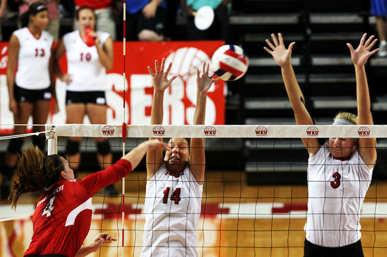 %C2%A0Lady+Topper+junior+middle+hitter%2C+Heather+Boyan%2C+right%2C+and+senior+setter%2C+Melanie+Stutsman%2C+left%2C+miss+a+spike+against+University+of+Cincinatti+sophomore+defensive+setter%2C+Morgan+Allred.+WKU+defeated+the+Bearcats+in+a+three-set+sweep.+%2825-15%2C+25-10%2C+25-14%29%C2%A0