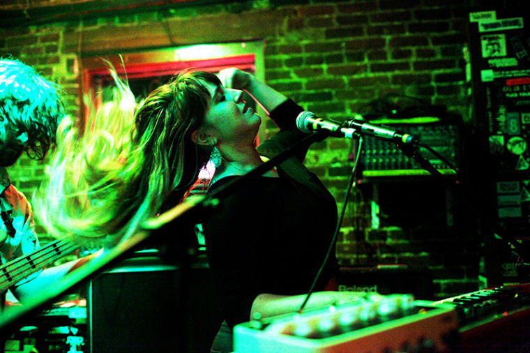 Buffalo Rodeo vocalist and keyboardist, Jordan Reynolds, brushes the hair from her face during their performance at Tidballs Friday night.