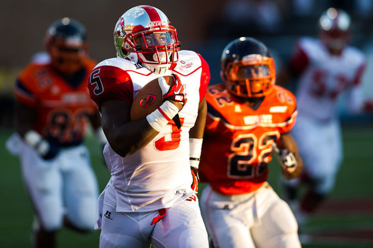 WKU's Antonio Andrews looks at the jumbotron as he returns the opening kickoff during their game against Morgan State at Western Kentucky University on Saturday, September 21, 2013.
