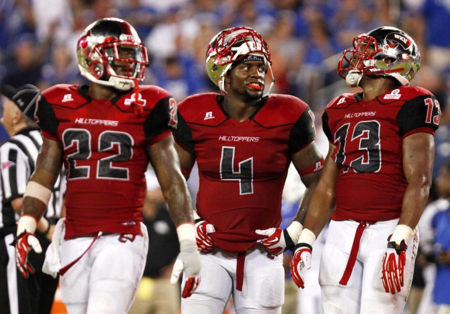 WKU+senior+defensive+back+Tyree+Robinson+%2822%29%2C+senior+linebacker+Andrew+Jackson+%284%29+and+senior+linebacker+Xavier+Boyd+%2813%29+all+watch+a+replay+of+a+Kentucky+touchdown+on+the+jumbotron+in+the+fourth+quarter+of+their+game+at+LP+Field+in+Nashville%2CTn.