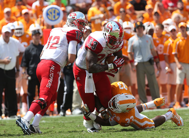 Quarterback Brandon Doughty watches as running back Leon Allen is tackled in the backfield by Tennessee defensive back LaDarrell McNeil during Saturday's game at Tennessee.