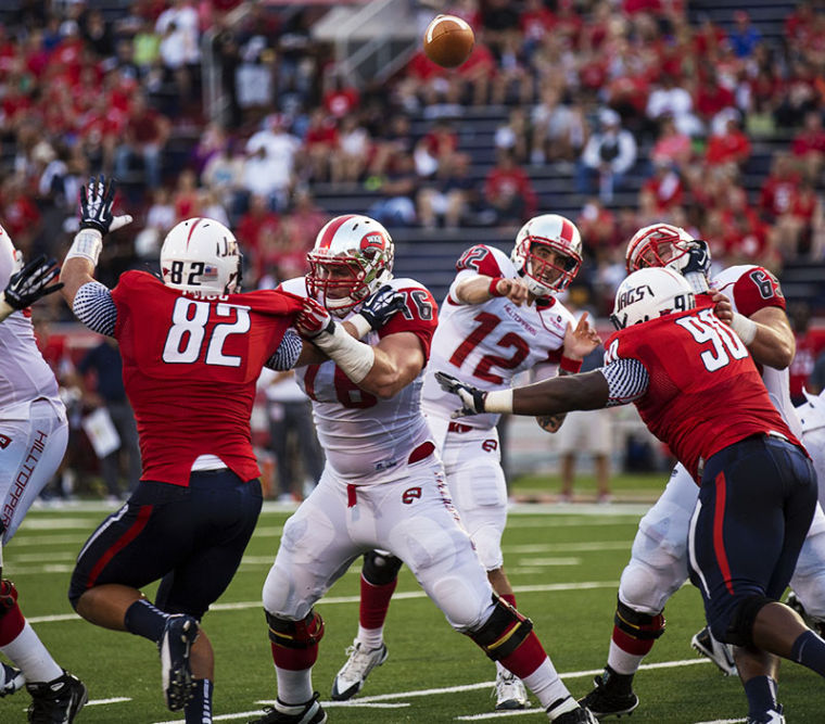 Quarterback+Brandon+Doughty+%2812%29+throws+through+traffic+during+the+first+half+of+WKU%E2%80%99s+game+against+Southern+Alabama+Sept.+14%2C+2013+at+Ladd+-+Pebbles+Stadium+in+Mobile+Ala.
