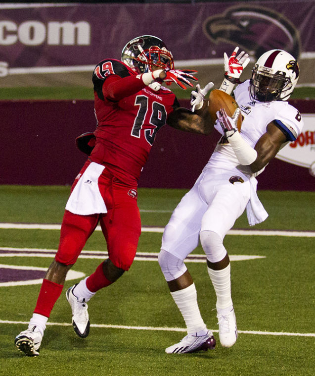 Defensive back Cam Thomas (19) gets an arm inside wide receiver Tavarese Maye (8) to break up a pass on Western's one yard line during the first half of the WKU vs. University of Louisiana Monroe game Thursday, Oct. 3, 2013, at Malone Stadium in Monroe, La.