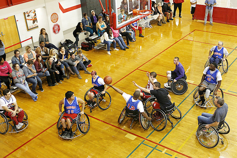 WKU students watched as participates and students played a game during the Wheelchair Basketbrawl Challenge at the Preston Center on Thursday. The Wheelchair Basketbrawl Challenge was presented by Student Disability Services as part of Disability Awareness Month.