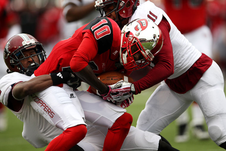 WKU%27s+wide+receiver+Willie+McNeal+is+tackled+after+making+a+first+down+catch+during+the+first+half+of+their+game+against+Troy+at+Western+Kentucky+University+on+Saturday%2C+October+26%2C+2013.%C2%A0