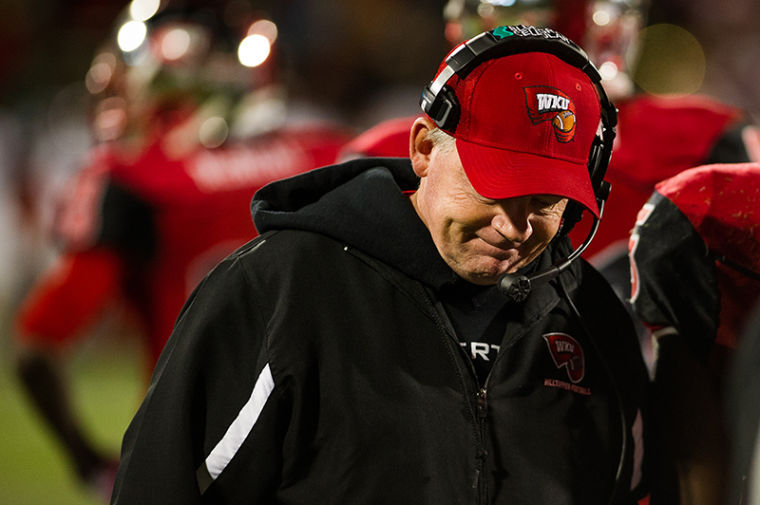 Western Kentucky University coach Bobby Petrino reacts after losing a challenge to maintain possession with less than two minutes left in the game. Western would go on to lose 32-26 at home on Saturday, October 26, 2013.