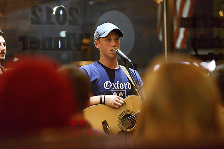 Louisville alumni Jordan Minton, 23, sings to a packed Lost River Pizza Friday night.
