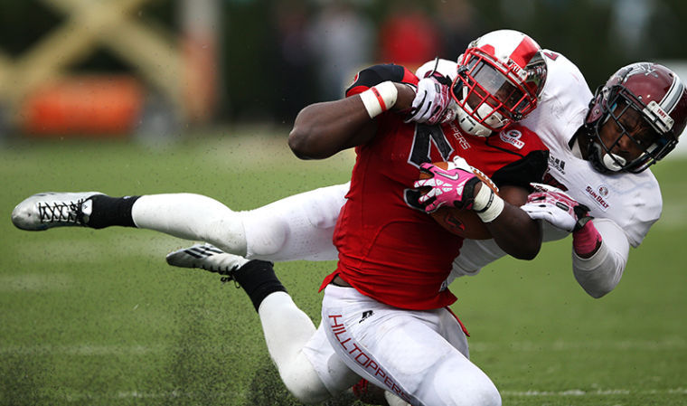 Running+back+Antonio+Andrews+is+tackled+by+safety+Chris+Pickett+during+their+game+against+Troy+at+Western+Kentucky+University+on+Saturday%2C+October+26%2C+2013.%C2%A0
