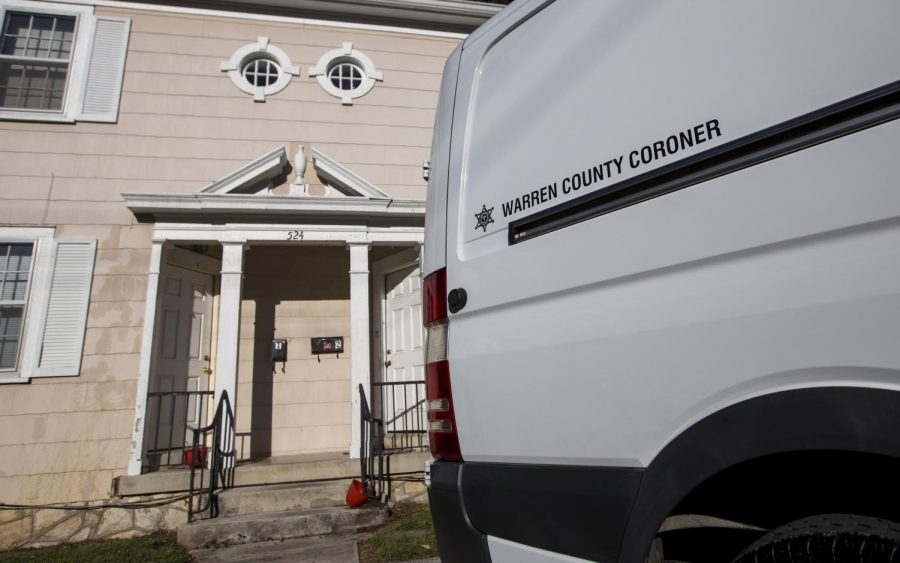 A Warren County Coroner van parked outside of 524 E. 14th St., across the street from Thompson Complex North Wing, following a death on Tuesday, Oct. 8, 2013.