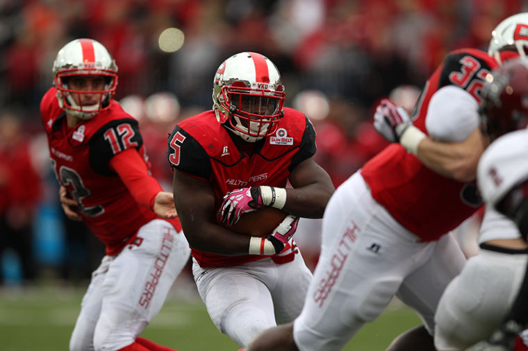 Running back Antonio Andrews carries the ball during the first quarter of their game against Troy at Western Kentucky University on Saturday, October 26, 2013.