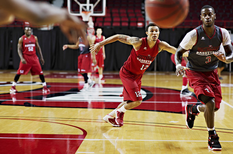 Senior guard Brandon Harris, second from right, covers junior guard Trency Jackson during a drill at the Hilltoppers' first practice of the season at Diddle Arena on Oct. 7.