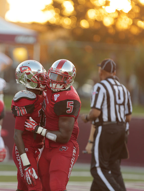 WKU junior wide receiver Willie McNeal celebrates with senior running back Antonio Andrews after McNeal's first quarter touchdown against Louisiana-Monroe during the first half of their game at Malone Stadium in Monroe, Louisiana.