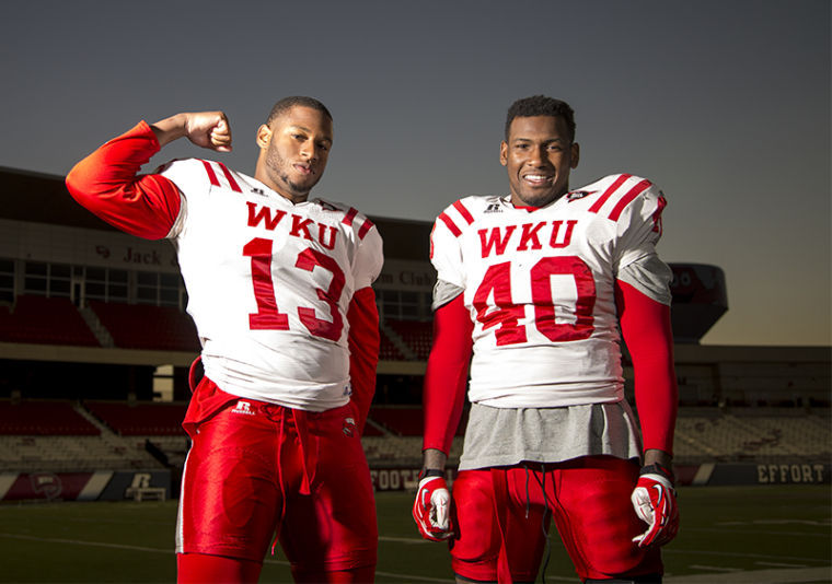 Linebackers Xavius Boyd (13) and Bar'ee Boyd (40) pose for a portrait inside the Houchens Industries-L.T. Smith Stadium Wednesday.