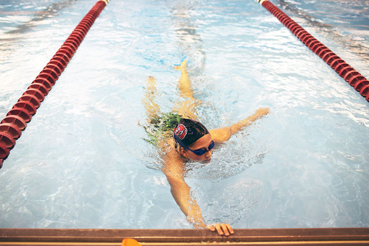 Murfreesboro, Tenn., freshman swimmer glides into the wall after completing a breath control set in practice Wednesday afternoon.