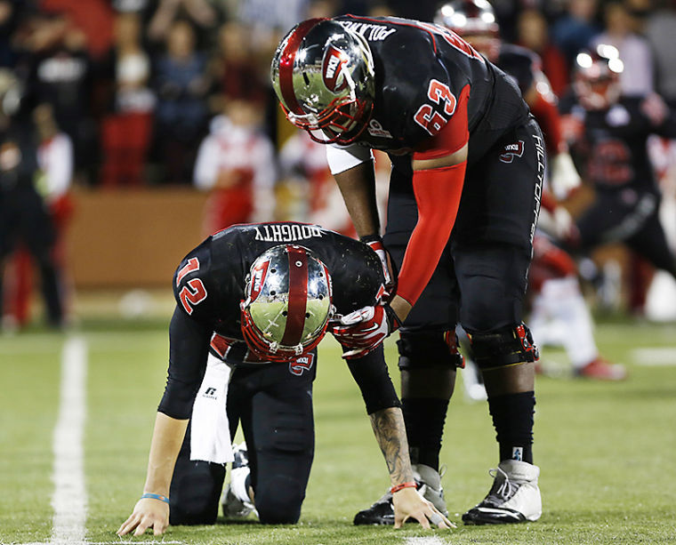 WKU%27s+quarterback+Brandon+Doughty+is+slow+to+get+up+after+being+hit+during+their+game+against+Louisiana+at+Western+Kentucky+University+on+Tuesday%2C+October+15%2C+2013.%C2%A0