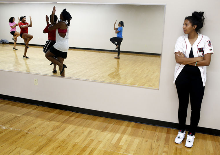 Nashville senior Courtney Buggs watches while members of Alpha Kappa Alpha practice their homecoming step routine for their upcoming step show this Saturday at Diddle Arena.