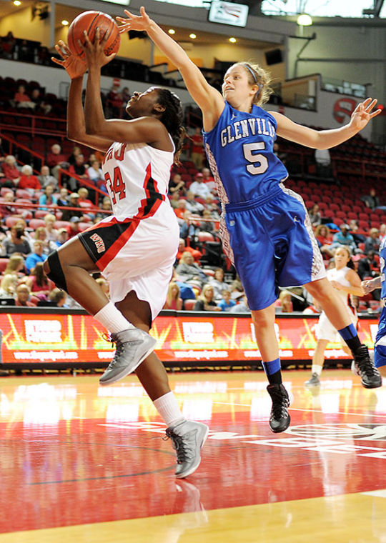 WKU junior guard Alexis Govan attempts to score while Glenville State College's senior guard Jessica Parsons attempts to block it during WKU's exhibition win at Diddle Arena 100-67.