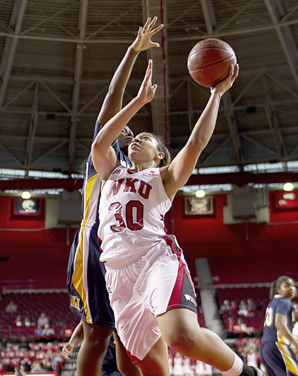 Junior+forward+Chastity+Gooch+%2830%29+goes+up+for+a+layup+as+forward+Jashae+Lee+%2842%29+guards+her+during+WKU%E2%80%99s+86-63+win+over+Murray+State+Saturday+at+Diddle+Arena.