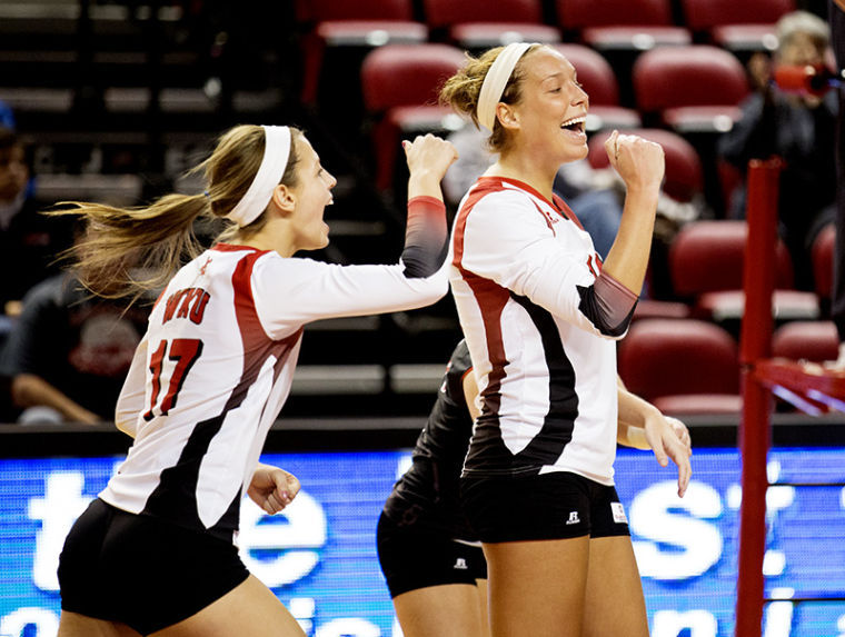 Setter Melanie Stutsman, right, celebrates after the Lady Toppers make it match point during WKU's 3-0 victory over Georgia State Wednesday, Nov. 13, 2013, at E.A. Diddle Arena in Bowling Green, Ky.