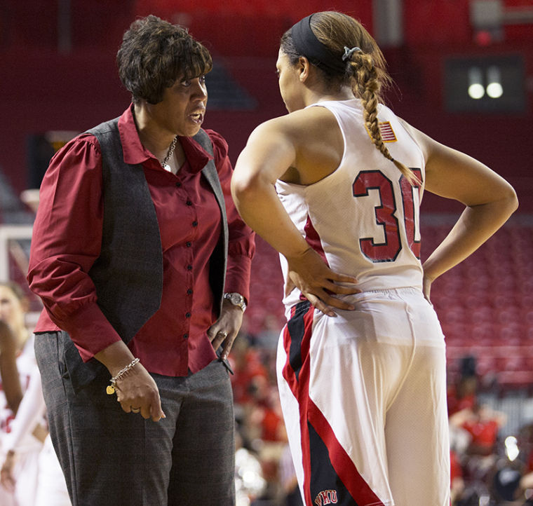 Head+coach+Michelle+Clark-Heard+speaks+with+forward+Chastity+Gooch+%2830%29+during+WKU%E2%80%99s+78-75+victory+over+Austin+Peay+Nov.+9%2C+2013%2C+at+E.A.+Diddle+Arena+in+Bowling+Green%2C+Ky.