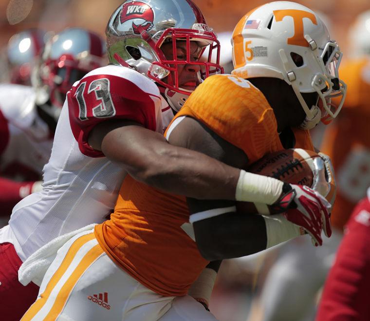 Senior+linebacker+Xavius+Boyd+tackles+Tennessee+receiver+Ryan+Jenkins+in+Knoxville%2C+Tenn.%2C+on+Saturday+at+Neyland+Stadium.