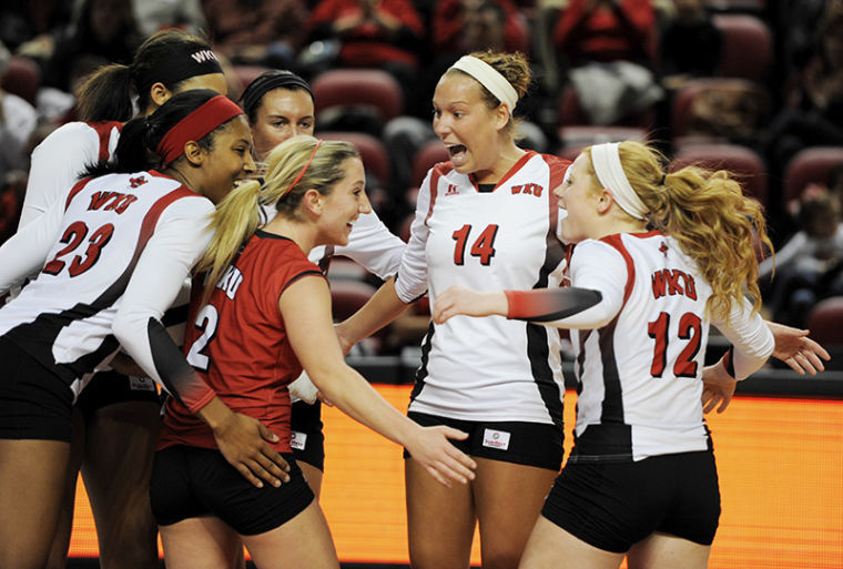Senior+setter+Melanie+Stutsman+%2814%29+celebrates+with+her+team+after+scoring+a+point+during+her+team%27s+game+against+University+Arkansas+Little+Rock.+The+Lady+Toppers+won+the+match+3-0.%C2%A0