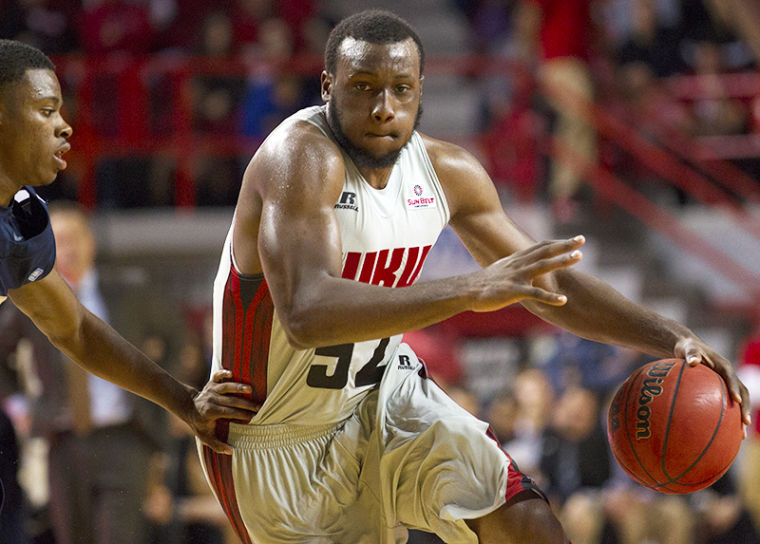 Junior guard T.J. Price (52) drives towards the basket as guard Jalen Riley (5) defends during WKU's 57-50 victory over East Tennessee State Saturday, Nov. 16, 2013, at E.A. Diddle Arena in Bowling Green, Ky.