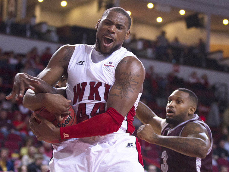 WKU junior forward George Fant attempts to recover a rebound during the exhibition game against Campbellsville at E.A. Diddle Arena on Saturday, Nov. 2.