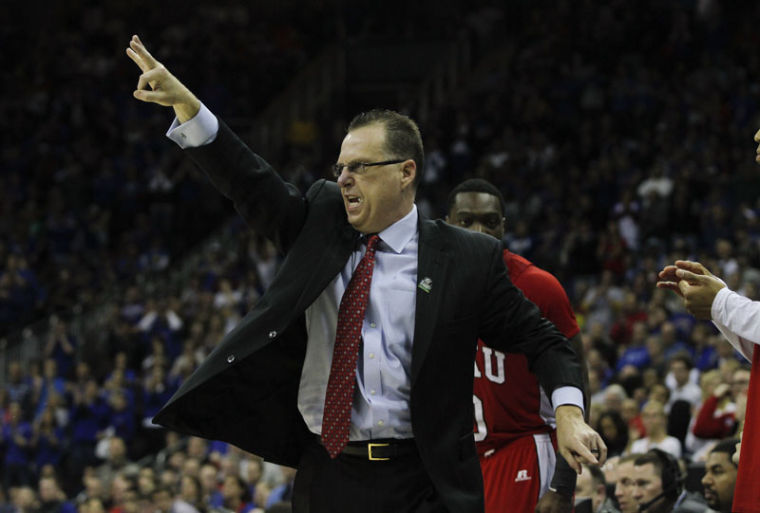 WKU Head Coach Ray Harper yells to his team in the second half March 22 at the Sprint Center in Kansas City, Mo. KU beat WKU 64-57.