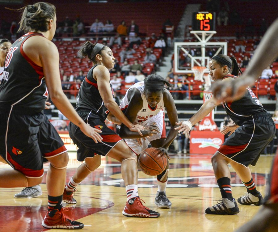 Junior+guard+Alexis+Govan+loses+control+of+the+ball+as+she+drives+the+ball+down+to+the+basket.+WKU+lost+74-61+against+No.+4+Louisville+on+Nov.+27%2C+2013+at+Diddle+Arena.