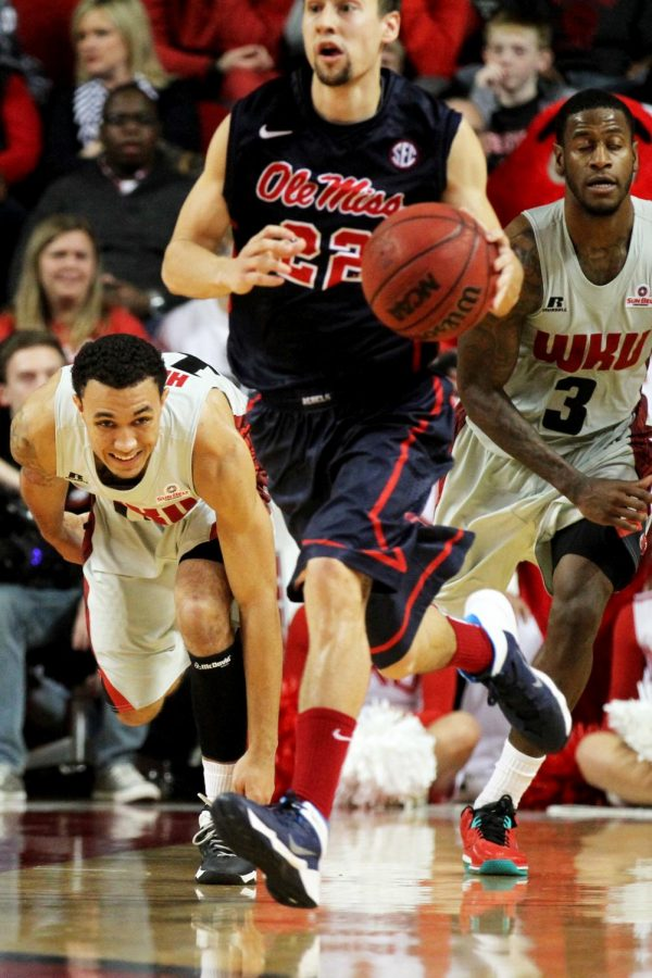 Freshman Brandon Harris and junior Trency Jackson attempt to catch up to Ole Miss point guard Marshall Henderson during the final moments of the game at Diddle Arena on Dec. 30. WKU lost to Ole miss 74-79.