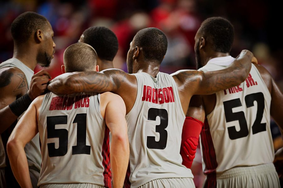 From left, WKU's George Fant, Chris Harrison-Docks, Trency Jackson, and T.J. Price congratulate each other after coming from behind to beat Murray State 71-64 at E.A. Diddle Arena on Saturday, December 21, 2013.
