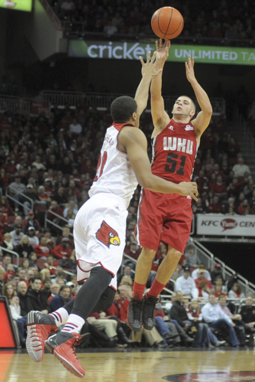 Freshman guard Chris Harrison-Docks shoots over Louisville junior guard Wayne Beshear during the game at KFC Yum center in Louisville, Ky. on Dec. 14. Harrison-Docks had 10 points and rebound in his season debut on Saturday.