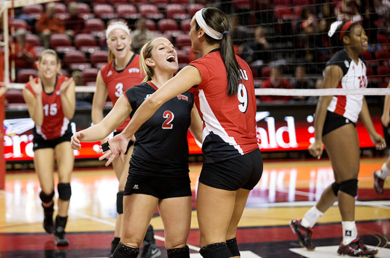 Defensive+specialist+Ashley+Potts+%282%29+celebrates+with+outside+hitter+Paige+Wessel+%289%29+after+a+point+during+WKU%E2%80%99s+3-0+win+against+the+University+of+Louisiana+Lafayette+Nov.+8%2C+2013%2C+at+E.A.+Diddle+Arena+in+Bowling+Green%2C+Ky.