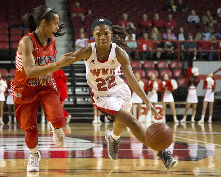 Guard+Bianca+McGee+%2822%29+drives+downcourt+as+guard+April+Rivers+%283%29+tries+to+defend+during+WKU%E2%80%99s+78-75+victory+over+Austin+Peay+Nov.+9%2C+2013%2C+at+E.A.+Diddle+Arena+in+Bowling+Green%2C+Ky.