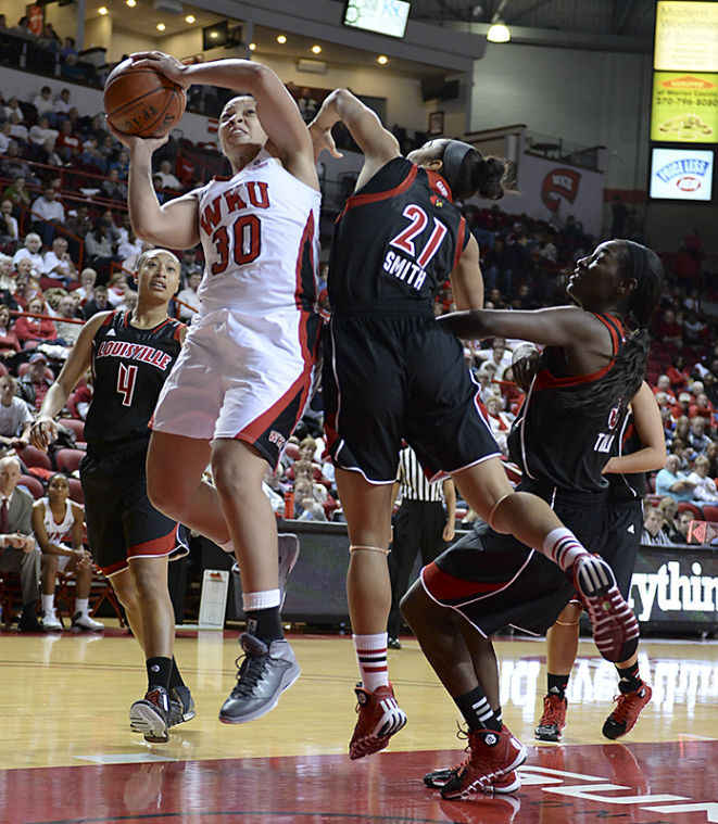 WKU+junior+Chastity+Gooch+drives+attempts+a+lay+up+during+WKU%27s+74-61+loss+against+%234+Louisville+on+Nov.+27%2C+2013+at+E.A.+Diddle+Arena.