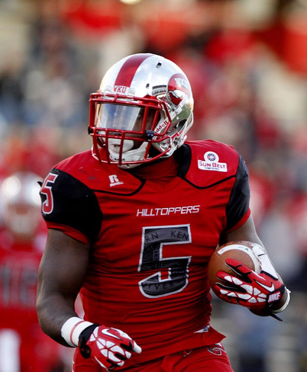 Western Kentucky Hilltoppers running back Antonio Andrews (5) runs around the outside during the first half of Saturday's game against Arkansas State. Western Kentucky lead 20-14 at the half.