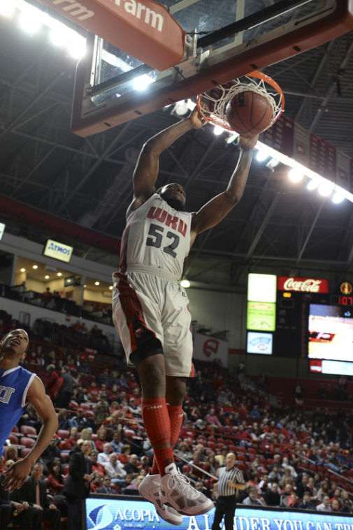 Junior T.J. Price dunks the ball. WKU won 68-53 against Eastern Illinois on Nov. 30, 2013 at EA Diddle Arena.