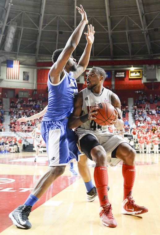 November 30, 2013, Bowling Green, Kentucky, USA_ | Junior George Fant looks to shoot the ball in WKU's 68-53 win against Eastern Illinois on Nov. 30, 2013 at EA Diddle Arena.