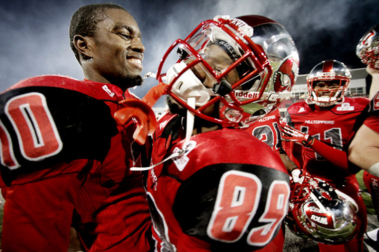 Western Kentucky Hilltoppers wide receiver Willie McNeal (10) and receiver Stephon Brown (89) celebrate Western Kentucky's 34-31 victory over Arkansas State in the last home game of the season.