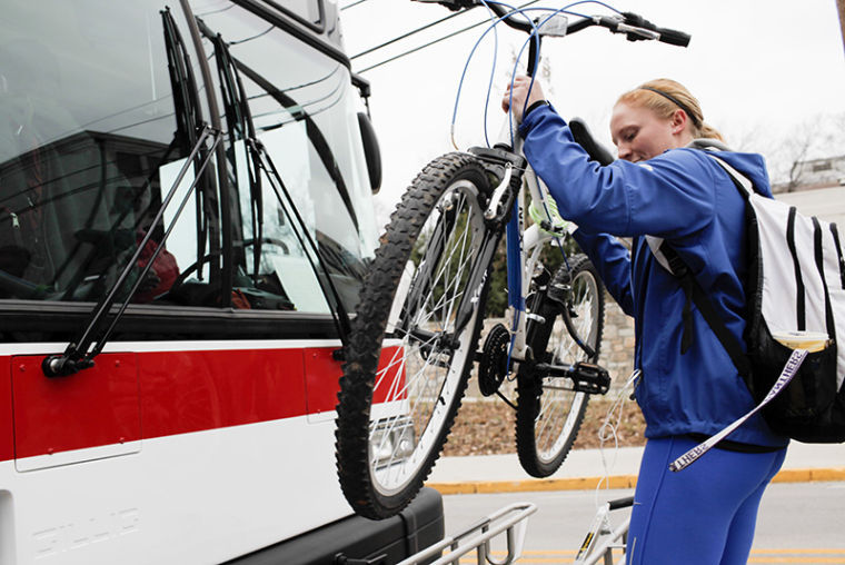 Sumner%2C+Iowa%2C+junior+Jodi+Miller+removes+her+bike+from+a+rack+in+front+of+a+WKU+bus+on+Normal+Drive+Monday.%C2%A0