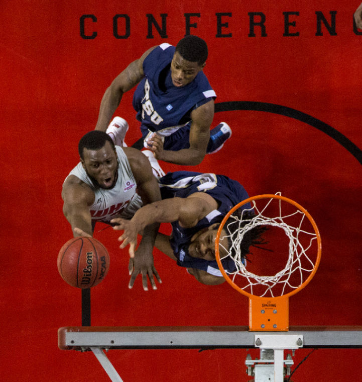 Guard T.J. Price (52) shoots over forward Hunter Harris (bottom) and guard Jalen Riley during WKU's victory over East Tennessee State Saturday, Nov. 16, 2013, at E.A. Diddle Arena in Bowling Green, Ky. Mike Clark/HERALD