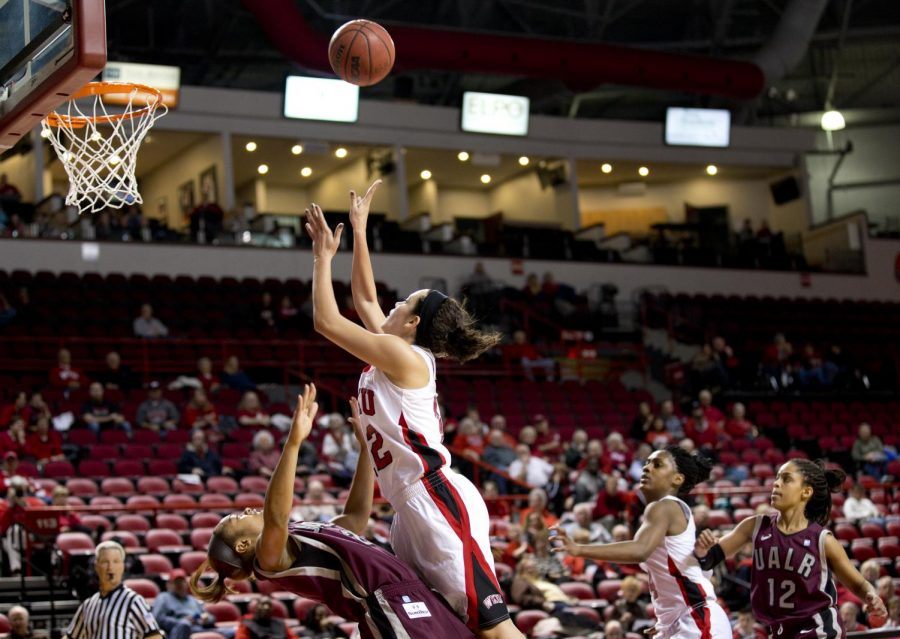 UALR+guard+Taylor+Ford+draws+a+charge+from+WKU+freshman+guard+Kendall+Noble+during+the+first+half+of+WKU%27s+game+against+the+University+of+Arkansas+Little+Rock+Wednesday%2C+Jan.+15%2C+2014+at+Diddle+Arena+in+Bowling+Green%2C+Ky.
