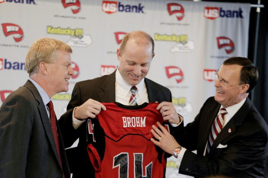 WKU+athletic+director+Todd+Stewart+%28left%29+and+WKU+president+Gary+Ransdell+%28right%29+present+new+WKU+head+football+coach+Jeff+Brohm+with+a+jersey+during+the+press+conference+in+which+Brohm+was+introduced+on+Friday%2C+Jan.+10.