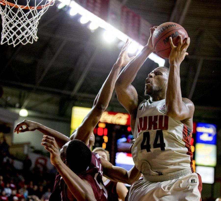 WKU junior forward George Fant goes up for a shot while the Toppers trail by one point with ten seconds left in overtime during WKU's 83-87 loss against the University of Arkansas Little Rock Thursday, Jan. 16, 2014 at Diddle Arena in Bowling Green, Ky.