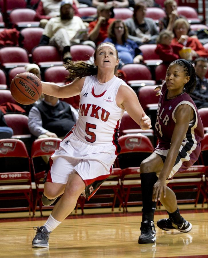 WKU+sophomore+guard+Micah+Jones+gets+around+UALR+guard+Taylor+Gault+and+drives+towards+the+basket+during+the+first+half+of+WKU%27s+game+against+the+University+of+Arkansas+Little+Rock+Wednesday%2C+Jan.+15%2C+2014+at+Diddle+Arena+in+Bowling+Green%2C+Ky.